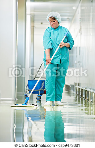 Woman cleaning hospital hall - csp9473881