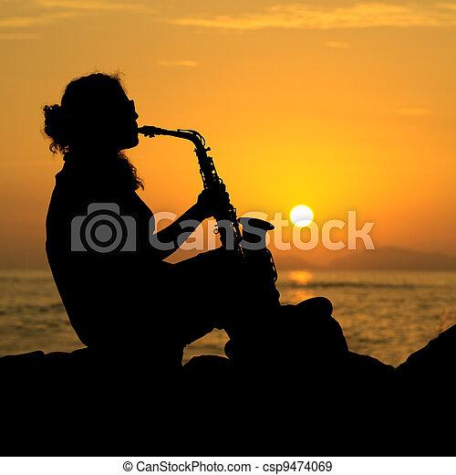Woman Playing the Saxophone - csp9474069