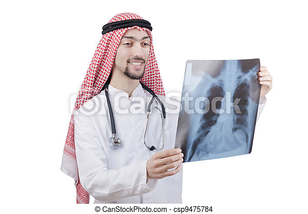 Arab doctor examining x-ray print - csp9475784