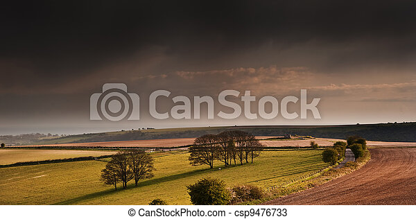 Stunning landscape with stormy sky over rural hills - csp9476733