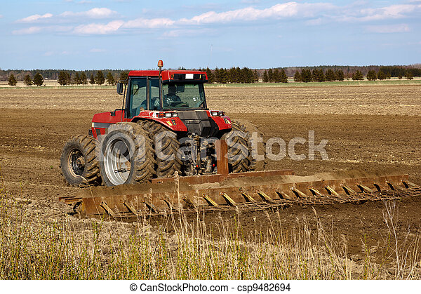 Tractor cultivated field - csp9482694