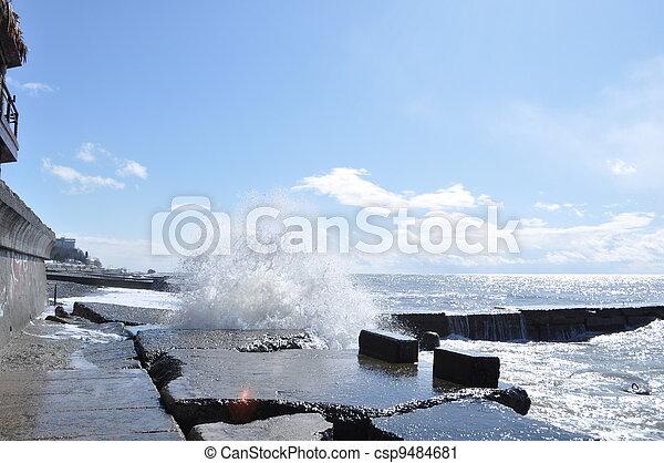 Sea waves breaking on concrete port