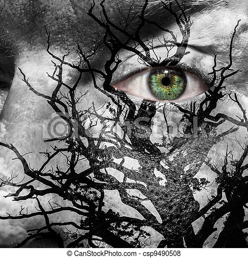 Face with green eye painted with medusa like tree - csp9490508