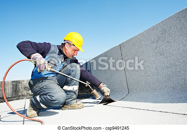Flat roof covering works with roofing felt - csp9491245
