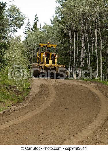 Grader resurfacing narrow rural road - csp9493011