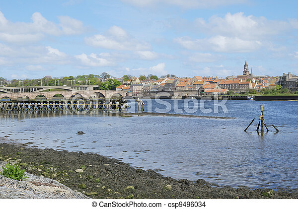 looking over the river Tweed to Berwick-upon-Tweed medieval city walls,bridges, spire, houses and wooden pier - csp9496034