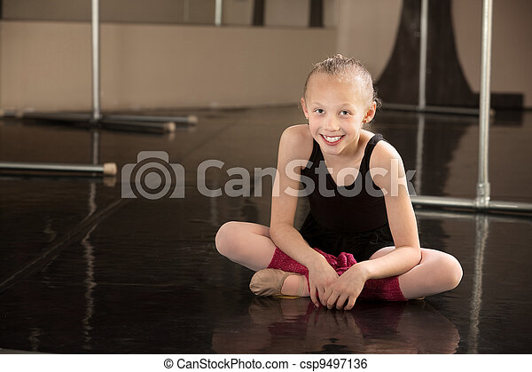 Stock image of happy ballerina sitting on floor cute for Dance where you sit on the floor