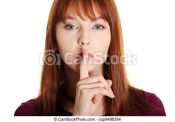 Young woman gesturing for quiet - csp9498354