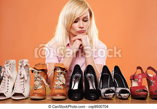 Fashion conscious woman with shoes - csp9500704