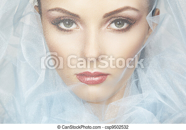 Fashion photo of beautiful women under blue veil - csp9502532