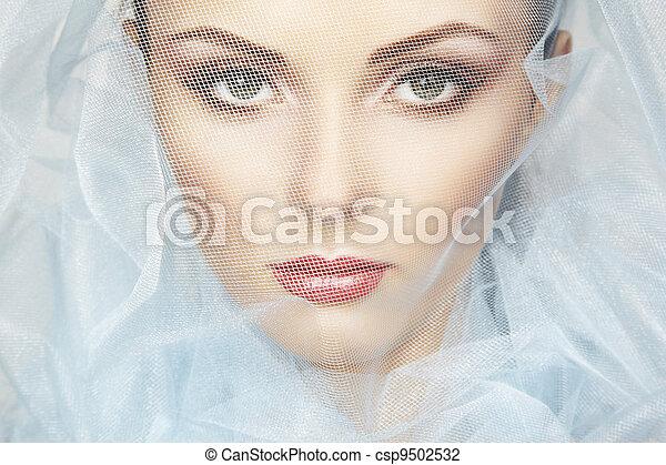 Fashion photo of beautiful women under blue veil - csp9502532