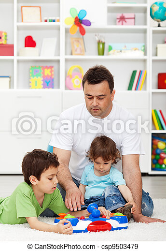 Father spending time with kids at home - csp9503479