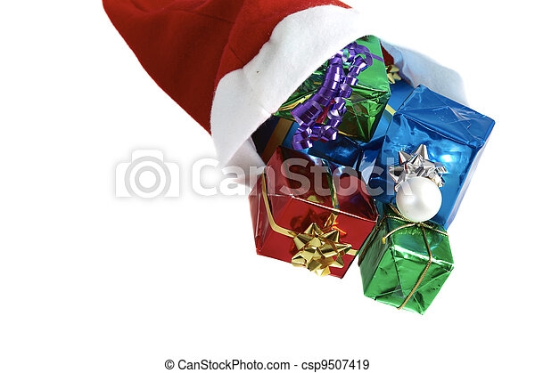 Many colorful christmas gifts in a santa claus cap on white background - csp9507419