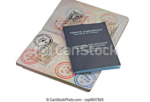 UK passport with Turkish visitor visa's and residence permit - csp9507825