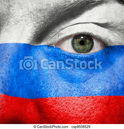 Flag painted on face with green eye to show Russia support - csp9508529