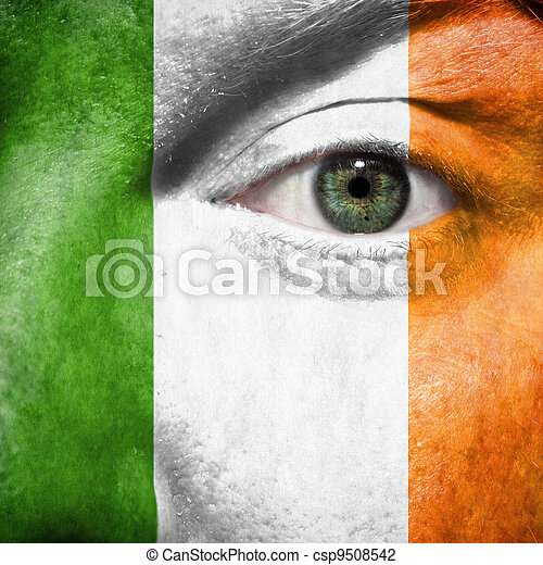 Flag painted on face with green eye to show Ireland support in sport matches - csp9508542