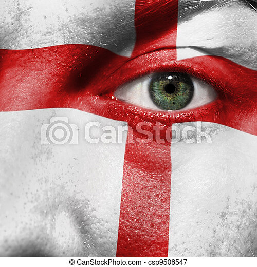 Flag painted on face with green eye to show England support - csp9508547