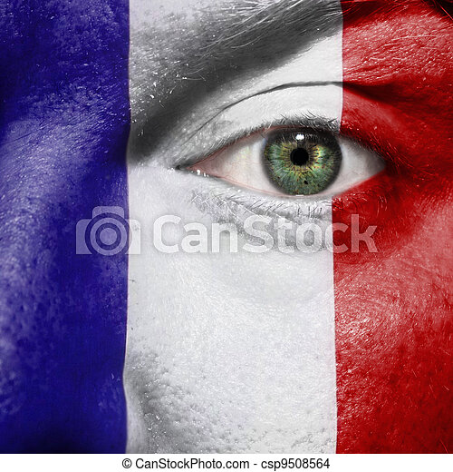 Flag painted on face with green eye to show France support - csp9508564