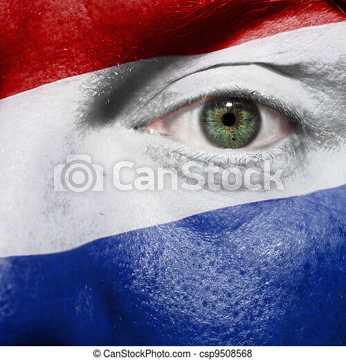 Flag painted on face with green eye to show Netherlands support in sport matches - csp9508568