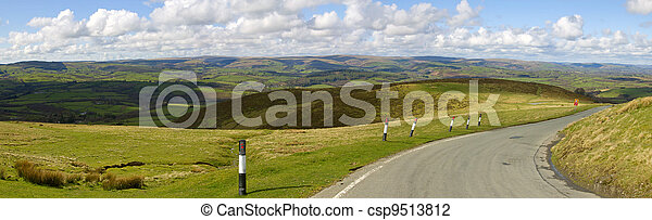 Panoramic view narrow road Welsh hills from the Mynydd Epynt, Wales UK. - csp9513812
