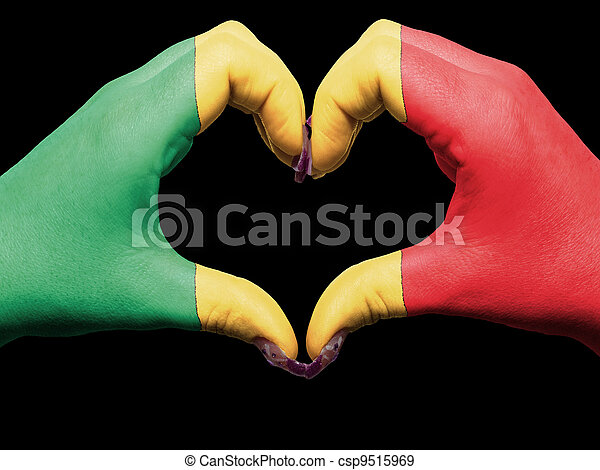 Tourist made gesture  by mali flag colored hands showing symbol of heart and love - csp9515969