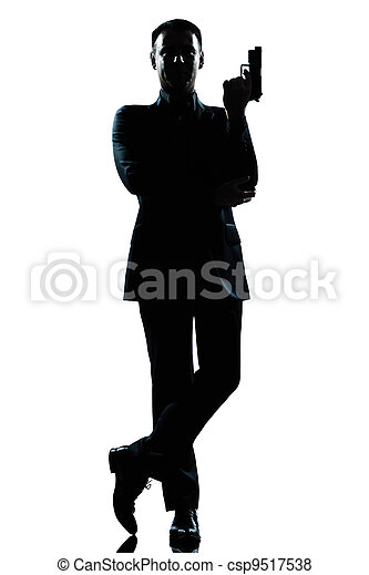 silhouette man full length secret agent in a james bond posture - csp9517538
