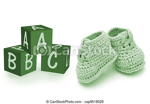 Hand-made baby booties and blocks - csp9518028