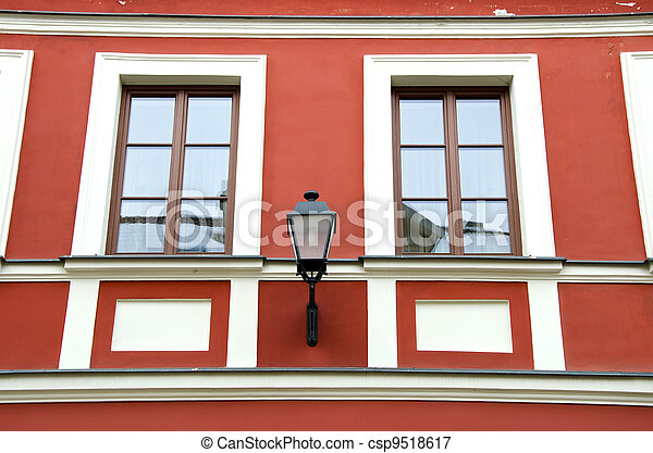 Renovated ancient building wall and retro lamp  - csp9518617