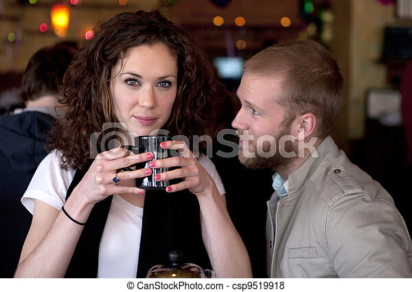 Couple in the restaurant relationship moment. - csp9519918