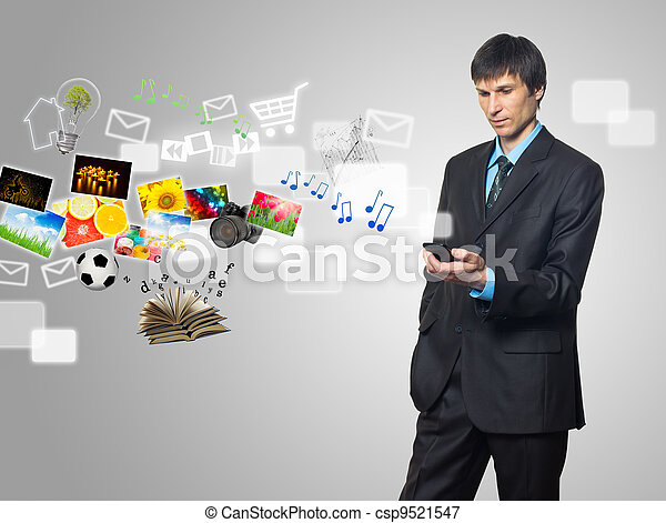 Businessman using mobile phone with touch screen with streaming images, email, multimedia symbols - csp9521547