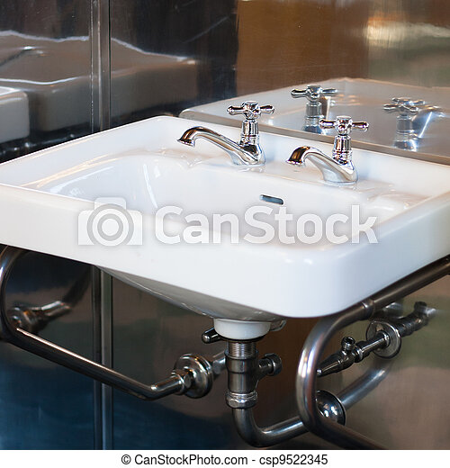 Stock Photo   Vintage bathroom sink mounted in a metal wall. Stock Images of Vintage bathroom sink mounted in a metal wall