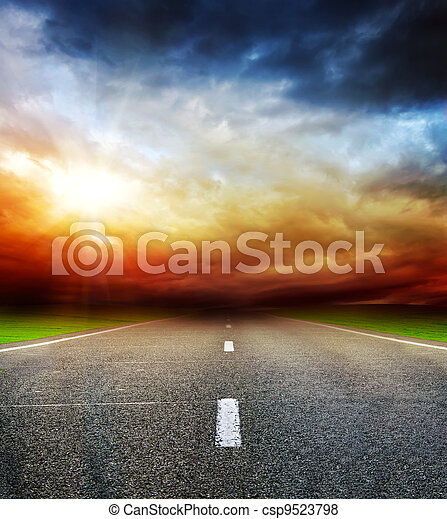 road in field over stormy dark cloudy sky - csp9523798
