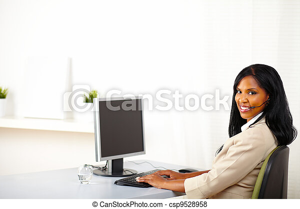 Attractive call center operator at work