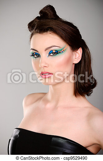 young beautiful woman with makeup in black dress - csp9529490