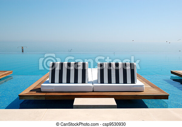 Infinity swimming pool by beach at the modern luxury hotel, Pieria, Greece - csp9530930