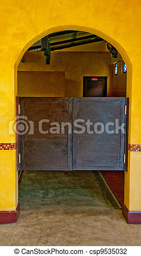 The Old wooden door saloon mexican style - csp9535032