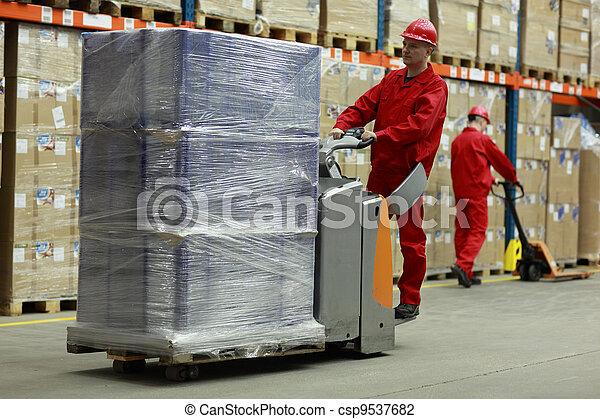 Warehousing - people at work - csp9537682