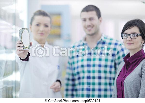 pharmacist suggesting medical drug to buyer in pharmacy drugstore - csp9539124