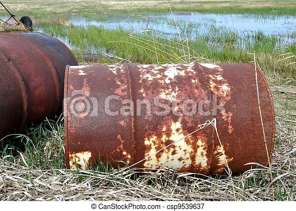 Pollution, old rusty barrels. - csp9539637