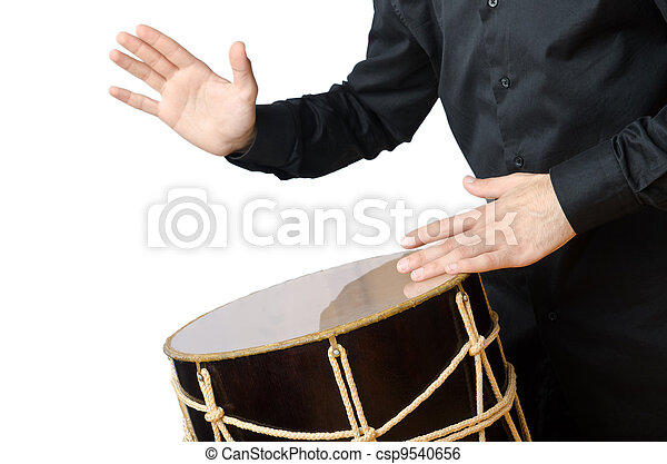 Drummer with drum playing on white - csp9540656