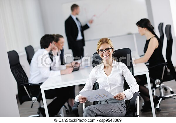 business woman with her staff in background - csp9543069