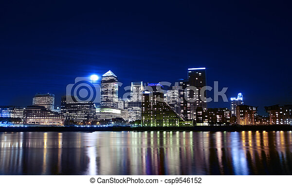 Canary wharf across the Thames at night - csp9546152