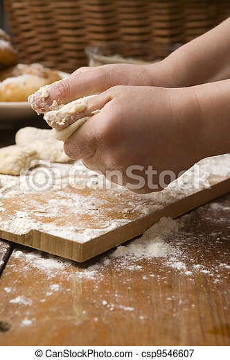 Detail of hands kneading dough - csp9546607