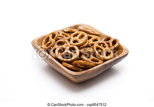 Salted pretzel in wooden bowl - csp9547512