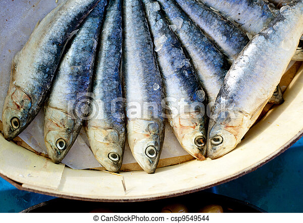 brine salted sardines in round wood box - csp9549544