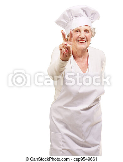 portrait of cook senior woman doing approval gesture over white background - csp9549661