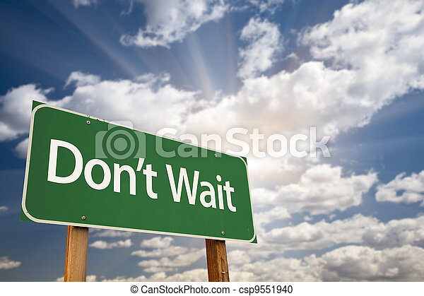 Don't Wait Green Road Sign and Clouds - csp9551940