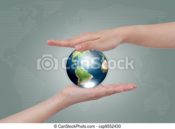 Two hands with earth  (Elements of this image furnished by NASA) - csp9552430