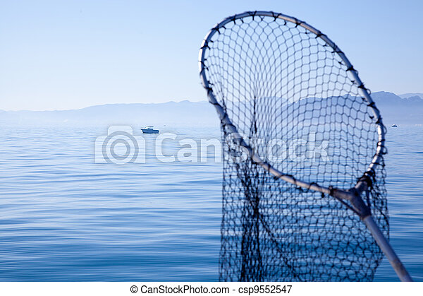 fishing landing net in blue sea - csp9552547
