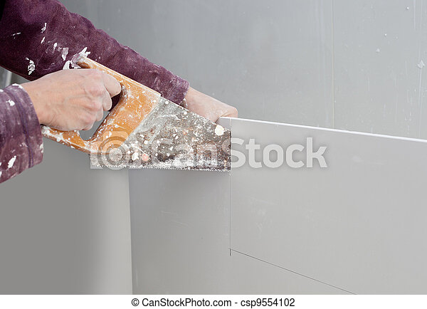 cutting plasterboard plaster hand dirty saw - csp9554102